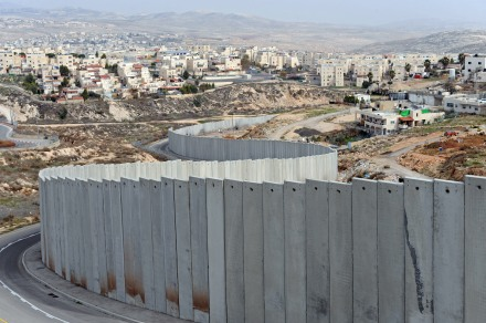 Israeli separation wall divides Shuafat Refugee Camp, Pisgat Zeev Israeli Settlement in West Bank